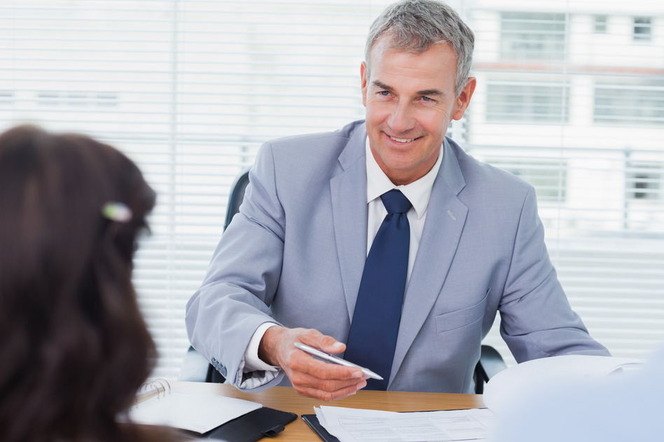 photodune-8461033-smiling-real-estate-agent-completing-contract-with-couple-in-bright-office-s