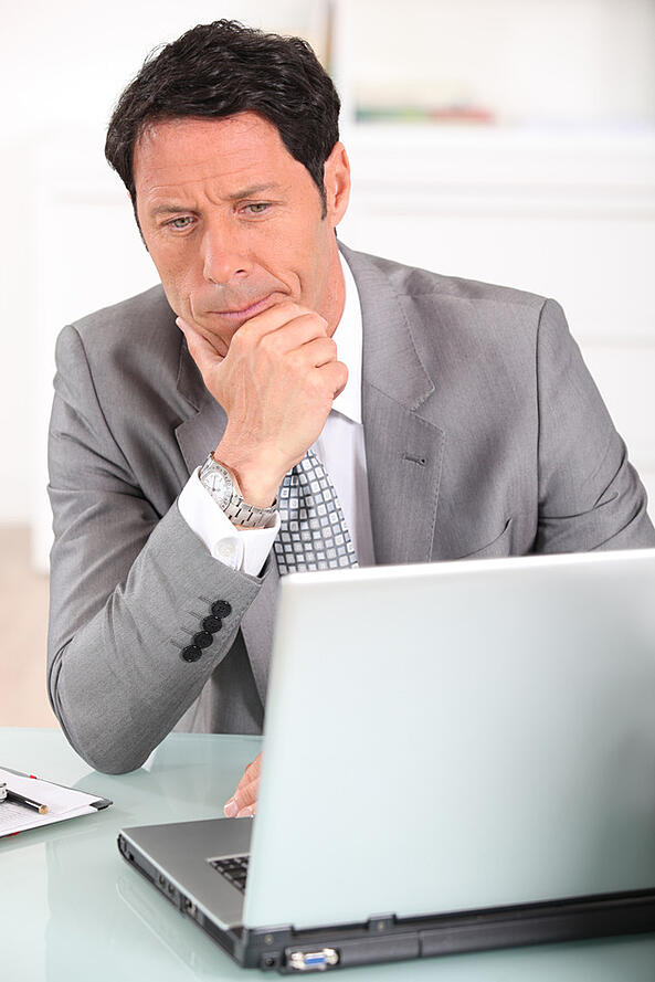 photodune-6258924-businessman-confused-by-his-laptop-s