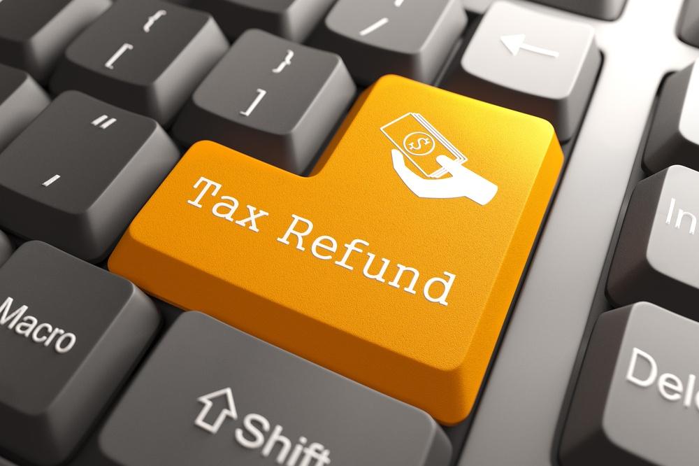 Tax Refund - Orange Button on Computer Keyboard. Internet Concept..jpeg