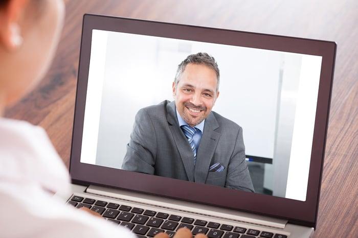 man_on_laptop_screen