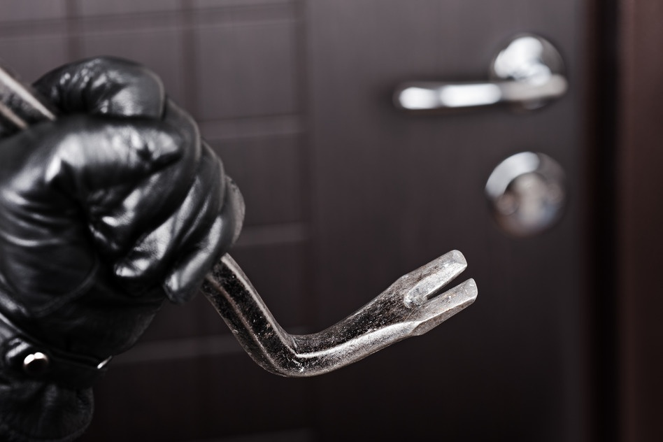 photodune-1046177-burglar-hand-holding-crowbar-break-opening-door-s.jpg