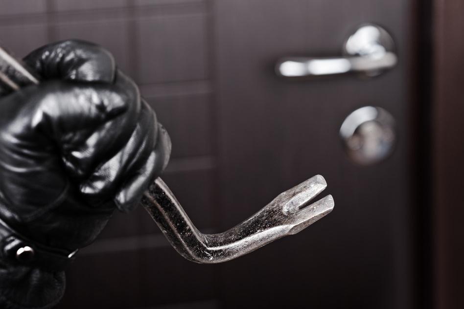 photodune-1046177-burglar-hand-holding-crowbar-break-opening-door-s.jpg