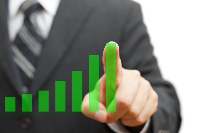 photodune-9460689-businessman-touching-growing-virtual-graph-column-positive-tren-s