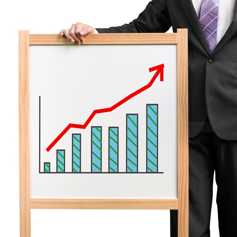 photodune-5806917-businessman-hold-wooden-white-board-with-flourish-market-trend-and-histogram-drawing-s.jpg